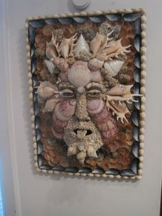 shell wall art. Now I know what to do with all my bags sea shells!