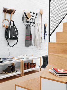 Organize on-the-go essentials.  As a portal to and from the outside world, an entryway should  serve well as a spot for keeping your accessories at the ready. Treat yourself to items that will help yours do exactly that.