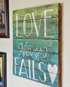 Painted Pallet Love Never Fails Sign