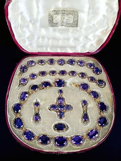 An early century gold and amethyst parure, circa the necklace composed of thirteen graduated oval mixed cut amethysts claw set in in cut down collets with beaded decoration and foliate cannetille connecting links to a concealed snap clasp,. Royal Jewelry, Jewelry Sets, Fine Jewelry, Silver Jewellery, Jewelry Stores, Victorian Jewelry, Antique Jewelry, Vintage Jewelry, Amethyst Jewelry