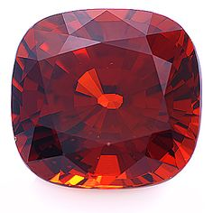 Medium red-orange Spessartite cushion weighing 10.53 cts. Spessartite is a rare form of garnet with an unusually high index of refraction. It has always been a rare stone. Discoveries in Mozambique and Nigeria led to an increase in production over the last few years. Although the output was significant, the percentage of fine material in larger sizes was very small.