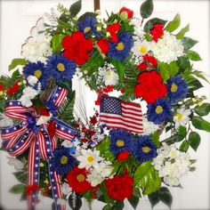 This is going on our backdoor to our garden this year, we decorate front and back, the back is for the family.  Patriotic and Festive Red, White and Blue Front Door Wreath with Colorful Flowers, American Flag, Patriotic Ribbon