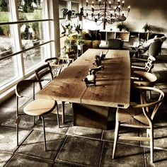 dk3_design_furnitureClassic Danish chairs surround our TREE TABLE LIMITED @interiorshop.dk in Kragelund/Denmark - we ❤️ #dk3 #treetablelimited #jacobplejdrup #interiorshop #solidoak #trueaesthetics #madeindenmark www.dk3.dk
