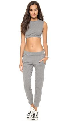 """This is a modern day Norma Kamali Sweats by Norma Kamali Crop Top. In the 80s, Kamali transformed conception of casual clothing with her Sweats collection. Each piece in the collection was made out of grey sweatshirt material. It was claimed to be """"Designer fashion meets athletic wear."""""""