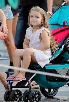 A princess in her element! The couple's four-year-old daughter Harper looked sweet as she sat in a stroller, while taking in the exciting surroundings of the park