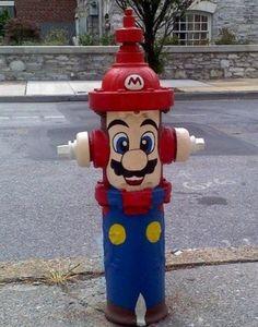 The fire hydrant is cosplaying Mario. hahahaha