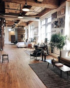 Schoolhouse Electric & Supply Co. in Portland, OR, by Michelle Madsen | An open space with industrial suspension lighting and several wood details. | Find more Vintage Industrial Style Interior Designs at http://www.vintageindustrialstyle.com