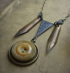 Vintage caramel bakelite button and Victorian pen nib necklace by Luminoddities $42