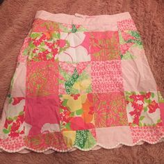 Lilly pulitzer skirt Lilly Pulitzer patchwork type skirt. 100% cotton. So adorable. Pink gingham waistband. Scalloped hem. Lace back pocket. Lilly Pulitzer Skirts