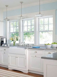 Bright white kitchen with the large windows. More via http://forcreativejuice.com/elegant-white-kitchen-interior-designs/