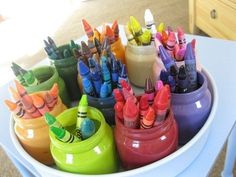 Keep crayons organized with style. | 23 Insanely Cool Things You Can Do With Baby Food Jars