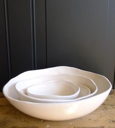 With a size to fit any entrée, side dish or snack, this set of ceramic serving bowls is a versatile addition to any china cabinet. The slightly irregular and organic shapes are formed by hand, with loping edges and a flat bottom on each piece. The bowls can also be stacked and nested, for tidy cleanup after dish duty.