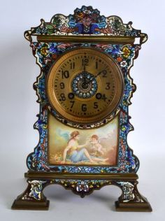 A 19TH CENTURY FRENCH BRONZE AND CHAMPLEVE ENAMEL