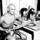 Yul Brynner and the accoutrements of the pharaoh of The Ten Commandments  -  Bald never looked as good on anyone else!