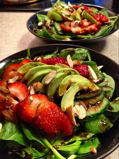 Strawberry spinach salad, with avocado, cucumber, almonds and balsamic vinaigrette.Yummy