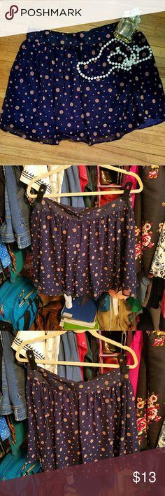 Polka dot circle skirt Zipper up back Pink polka dots, navy fabric Polka dots are of a softer material Fit: not stretchy Francesca's Collections Skirts Circle & Skater