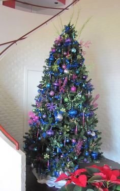 A less traditional Christmas tree was featured in Grey Rock restaurant for the 2011 season. Decorated with pink, blue purple and green ornaments. Feathers add a whimsical touch.