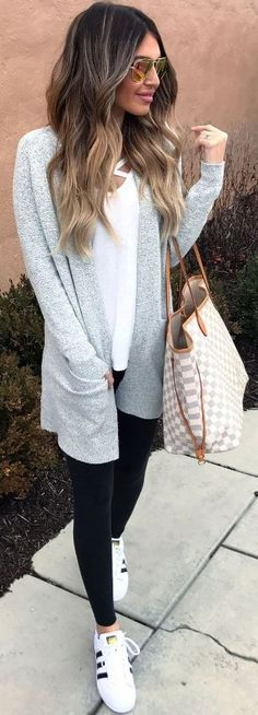 Grey sweater, white shirt, black leggings and white shoes