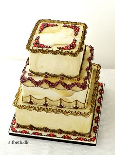 Gorgeous Wedding Cake ~   airbrushed, Sugar gold gilding, scrolling, and string work ~ , All decorations are royal icing in different shades of the same color as the fondant cover (Sugarflair Caramel). The flowers are royal icing  ~ all edible