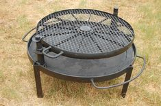 Cookie's Wagon Wheel BBQ | Etsy Fire Pit Grill, Fire Pit Backyard, Fire Pits, Steel Fire Pit Ring, Wagon Wheel Decor, Cast Iron Fire Pit, Wheel Fire Pit, Barbecue Pit, Diy Grill
