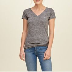 Grey hollister V neck **please note actual shirt is different from first pic which is used to illustrate fit** distressed grey v neck shirt with maroon hollister logo. Sleeve are sewn to have a fold as seen in last pic. Hollister Tops Tees - Short Sleeve