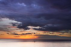 sunrise over water photos | North Point Sunrise Water Post, with Rain Storm Over Lake | Flickr ...