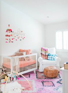 This colorful coral nursery totally strikes a cord with our personal style. The bright palette combined with bohemian nursery accents is fresh modern and fun! - September 07 2019 at Girl Nursery Colors, Bright Nursery, Coral Nursery, Baby Girl Nursery Themes, Nursery Modern, Nursery Design, Nursery Room, Nursery Decor, Nursery Ideas