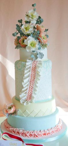 Springtime Wedding Cake ~ hand piped ( in baby blue) lace and all sugar flowers Wedding Cake  ~ all edible