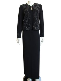 Gorgeous St. John Couture & St. John Evening by Marie Gray black Santana Knit skirt suit with sparkling rhinestone crystals! Perfect for a special occasion, or your next formal event - this beautiful two piece set features a short crystal studded jacket, and coordinating evening skirt. The jacket features a single hook and eye closure at the neck, satin cable trim, lightly padded shoulders, bracelet length sleeves, and a swirling pattern of black and marcasite (charcoal) colored rhinestone…