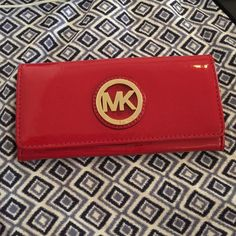 MK authentic wallet Chilli red Great used condition. Fits iPhone 6plus Michael Kors Bags Wallets