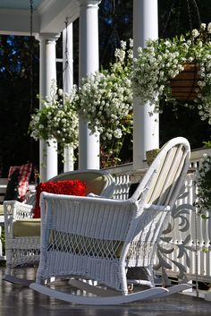 idyllic porch with pretty hanging baskets