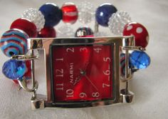 Show your loyalty to this great country by sporting this RED, WHITE and BLUE chunky beaded watch band. The beads are striped, polka dot and solid giving a pleasing look with depth and dimension. It is finished off with the rectangle red Narmi face with dainty hands. A real winner!