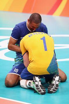 Sergio Dutra Santos and Bruno Rezende of Brazil celebrate after winning the…