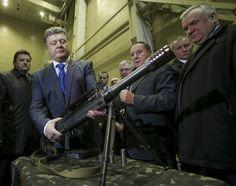 Развеселил Меркель и потряс булавой. Самые яркие фото Порошенко за 2014 год - Korrespondent.net