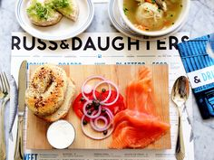 Russ & Daughters Cafe | 179 E Houston St., New York, NY. Worth the wait if you're visiting. But here's how i do it: order in bulk, to go, bring the goods to Roosevelt Park (steps away) and enjoy while watching a pick up b-ball game.