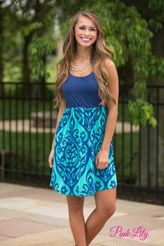 Conquer the fashion world in our sweet little mini dress! Featuring navy and jade in damask print, this dress will be a knockout at any formal or informal function! The fabric is also super soft and the dress has an elastic waistband for extra comfort. Pair it with wedges to complete the look!