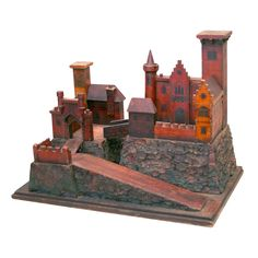 Painted Wooden Model of a Medieval Castle, 19th Century  England or Continental  19th Century  Painted Wooden Model of a Medieval Castle Compound with Gothic Windows, Battlements, Draw Bridge, and Parapets all Mounted on a Foundation Covered in Ruddy-Colored Painted Bark, 19th Century.        22 inches wide x 13 inches deep x 16 inches high