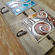Abstract Plaque(3 hooks). Embossed pewter with glass paint on a rustic wooden plaque $23