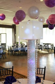 Modern, non-floral centerpiece by www.idealpartydecorators.com