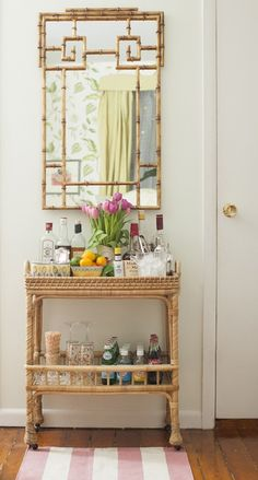 Matchbook Magazine: Lovely vignette of light green walls framing Gold Bamboo Mirror over Serena and Lily ...