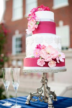 Beautiful four-tier white and hot pink wedding cake with floral decor.  Photo by Ely Fair Photography.  www.wedsociety.com  #wedding #cakes