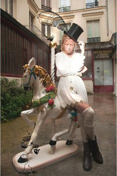 On a carousel, dressed by Mes Demoiselles... Paris