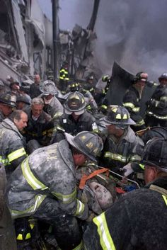 ADVANCE FOR SUNDAY, SEPT. 23--FILE--A fireman screams in pain during his rescue shortly after both towers of New York's World Trade Center collapsed following a terrorist attack, Tuesday, Sept. 11, 2001. An estimated 300 firefighters died at the trade center. (AP Photo/Robert Mecea, Newsday) MAGAZINES OUT, NO SALES, NO ONLINE, MANDATORY CREDIT. We Will Never Forget, Lest We Forget, We Remember, Always Remember, Remembering September 11th, World Trade Center Collapse, Trade Centre, Sad Day, Firefighters