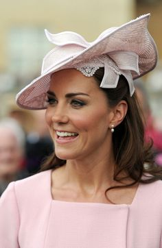 Kate attend the annual Garden Party at Buckingham Palace on May 29, 2012 in London. Wearing a pale pink and pleated Emilia Wickstead dress.
