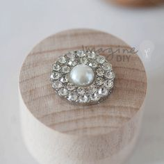 Small round pearl and crystal embellishment for decorating wedding invitations and DIY wedding stationery supplies. Paper craft, Pearl and crystal embellishments