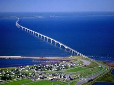 he Confederation Bridge joins the eastern Canadian provinces of Prince Edward Island and New Brunswick, making travel throughout the Maritimes easy and convenient. The curved, 12.9 kilometre (8 mile) long bridge is the longest in the world crossing ice-covered water, and a decade after its construction, it endures as one of Canada's top engineering achievements of the 20th century.