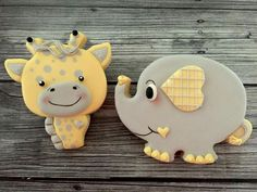 Delorse McCallum Sword:  giraffe & elephant decorated cookies for a baby shower.   Adorable!