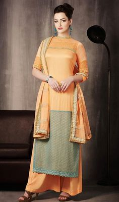 Charm and enchain the people in awe enfolding yourself in this orange shade georgette palazzo dress. The wonderful lace and resham work a vital feature of this dress. #TransparentNeckOrangePalazzoSuit