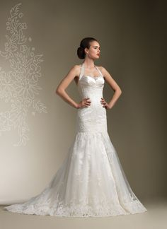 Justin Alexander wedding dresses style 8606 Satin pleated halter neckline accented with beading at the empire line accents this lace/tulle mermaid gown with chapel length train, Low back neckline with buttons on back zipper.