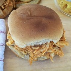 Crockpot BBQ Pulled Chicken - This super easy BBQ Chicken in the Crockpot was inspired by a delicious recipe by Paula Deen. The simple, homemade bbq sauce is so easy!